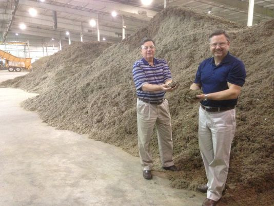 Mark Brown, right, the chief executive officer of WastAway, holds some of the fluff product made from trash while he and Terry Moore, the company's chief business development officer, stand before piles of fluff at their warehouse in Warren County. WastAway uses the fluff to create fuel and potting soil products. (Photo: Scott Broden/DNJ)